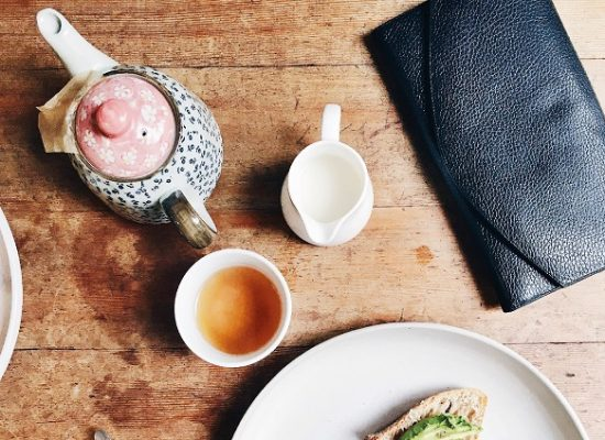 Purse and cup of tea cashless